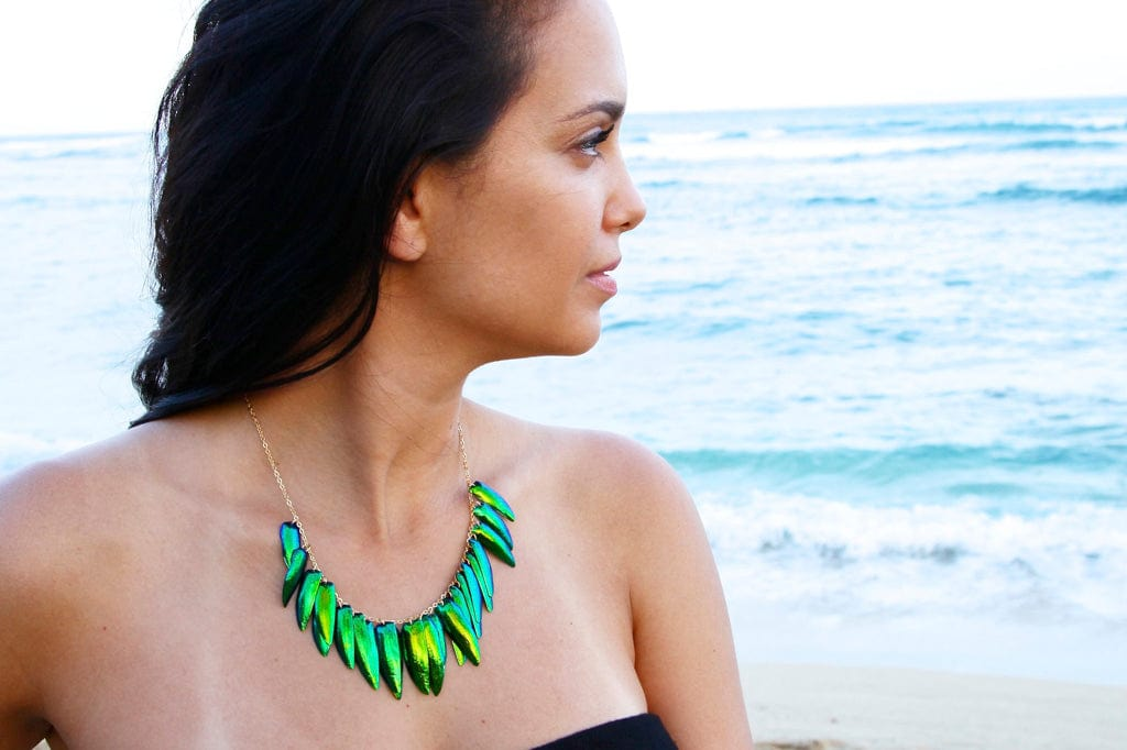 iridescent green scarab beetle wing fringe necklace on model