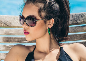 iridescent green scarab beetle wing earrings on model