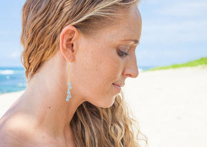 gemstone cascade earrings on model