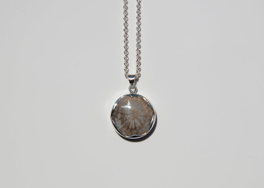 silver pendant with bezel set petrified coral