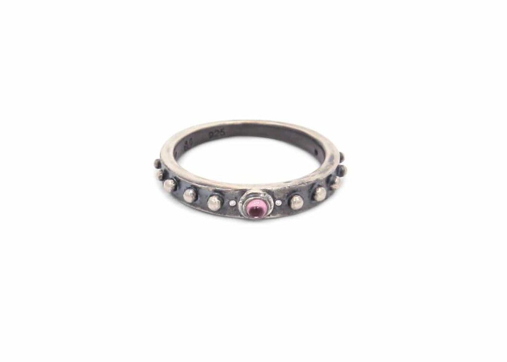 oxidized sterling silver nobby starfish ring with bullet shaped garnet stone
