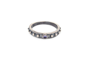 oxidized sterling silver nobby starfish ring with bullet shaped iolite stone