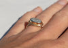 side view of 14k gold ring with snakeskin agate wrasse fish fossil on hand