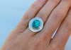 handmade sterling silver and turquoise statement ring with stamped sunburst pattern on model