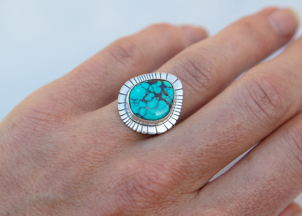 handmade teardrop shaped sterling silver and turquoise ring on model