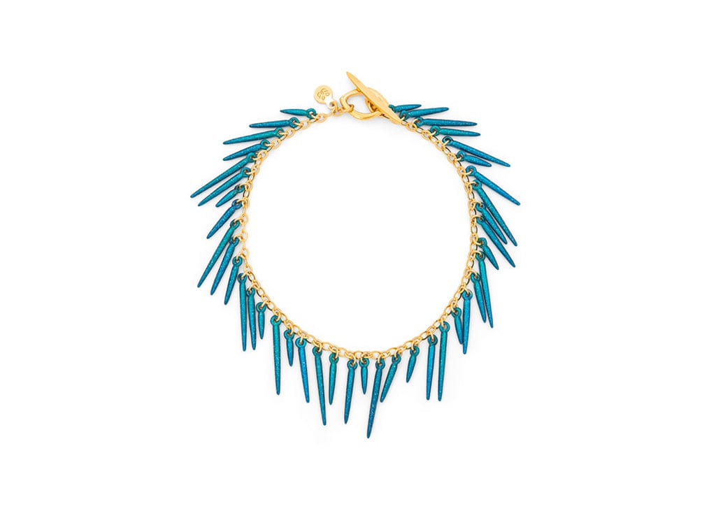 fringe style bracelet with blue powder coated spikes and 14k gold vermeil