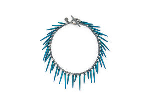 fringe style bracelet with blue powder coated spikes and oxidized sterling silver