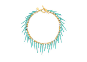 sea urchin inspired fringe bracelet with gold vermeil chain and seafoam blue powder coated spikes