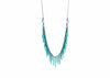 sea urchin inspired fringe necklace with oxidized silver chain and teal blue powder coated spikes