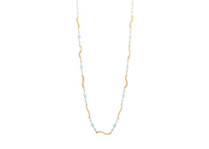 hammered 14k gold wave necklace with wire wrapped blue gemstones