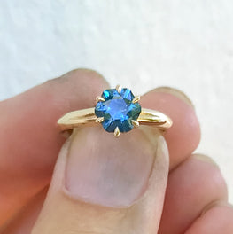10k gold engagement ring with claw set blue gemstone