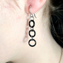 Load image into Gallery viewer, Picture of Model wearing Black and Silver Earrings.