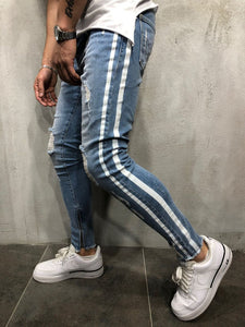 Trendy jeans with holes in the knee