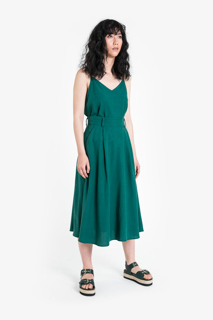 An aline skirt that drops beneath the knee in a bright jade green linen blend