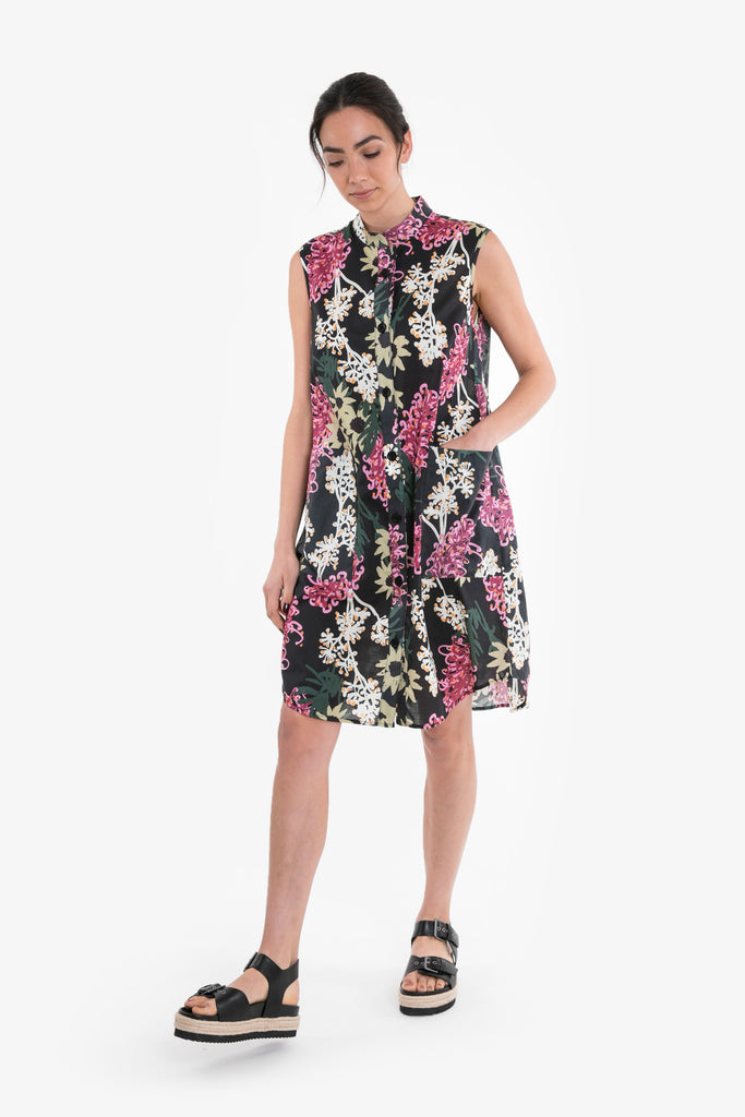 An above the knee shirt dress in a signature Obus large floral print