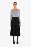 A knee-length vintage-style inverted pleat skirt made from wool with a crepe texture.