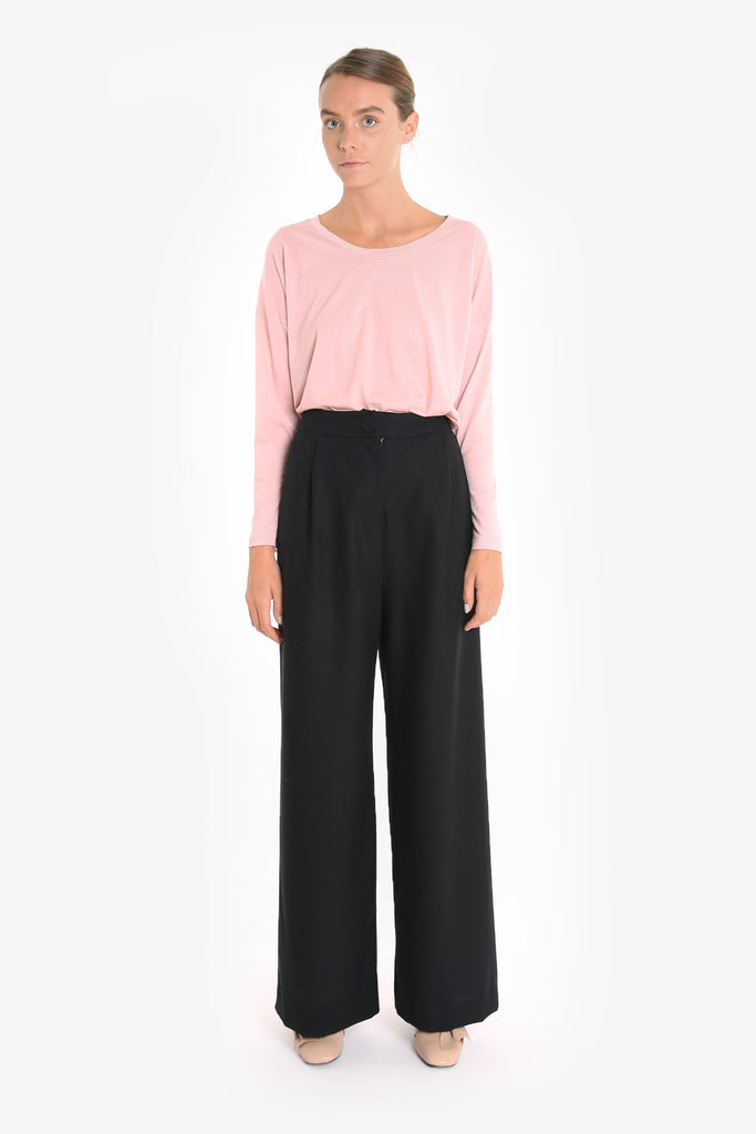 A wide-leg vintage-style flat front pant made from 100% wool.