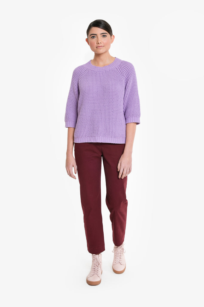 A chunky knit cotton jumper with three quarter sleeves in purple/lilac