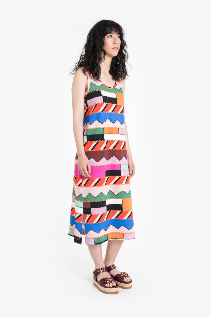 A wide legged, cropped dress with a tank top in a bold geometric pattern