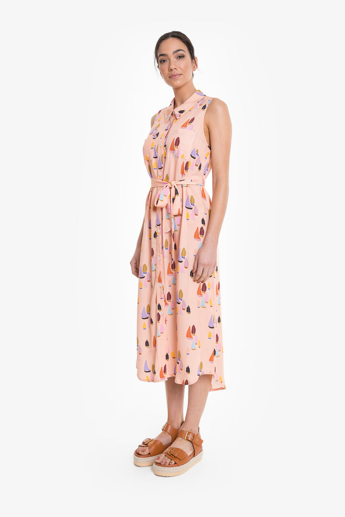 A full-length sleeveless shirt dress with waist tie in a signature Obus sailboat print in peach