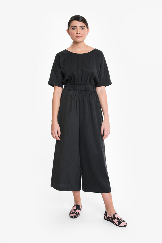 A black jumpsuit in a tencel/linen blend with cropped wide leg
