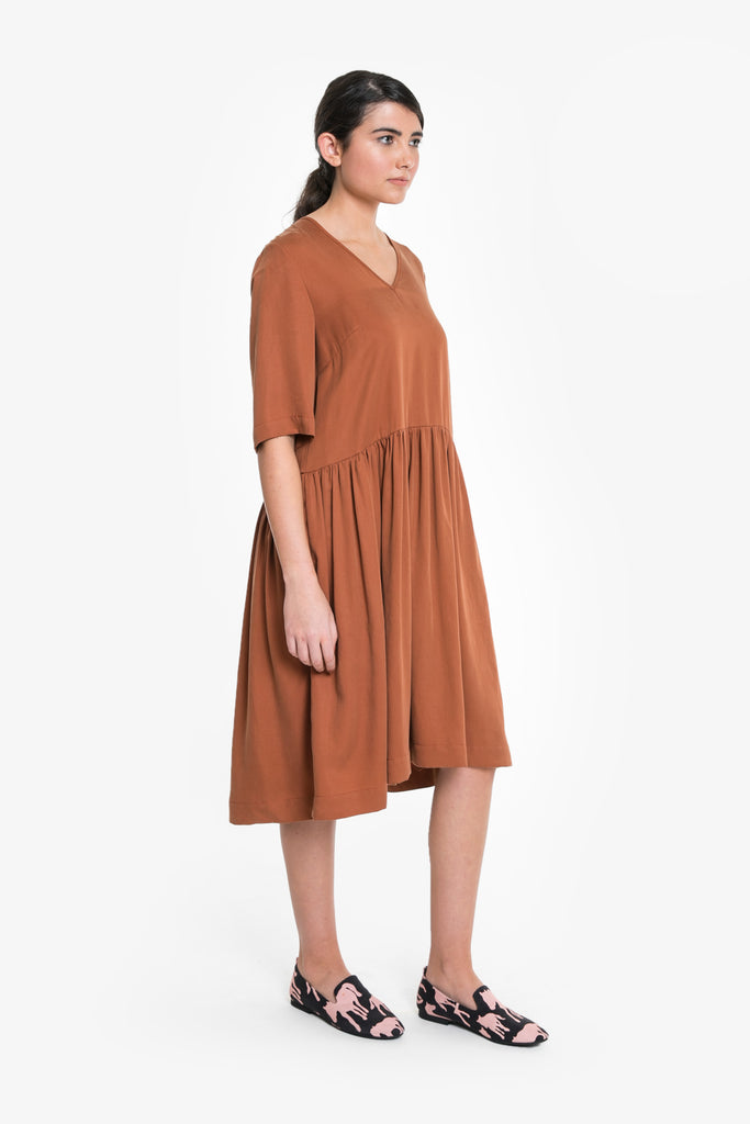 A relaxed fit summer smock dress in a tencel/linen blend with a v-neck
