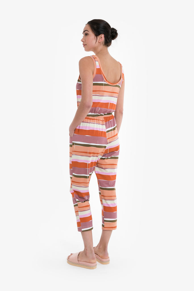 A graphic print of horizontal lines in premium jersey or linen blend, in a simple sleeveless playsuit