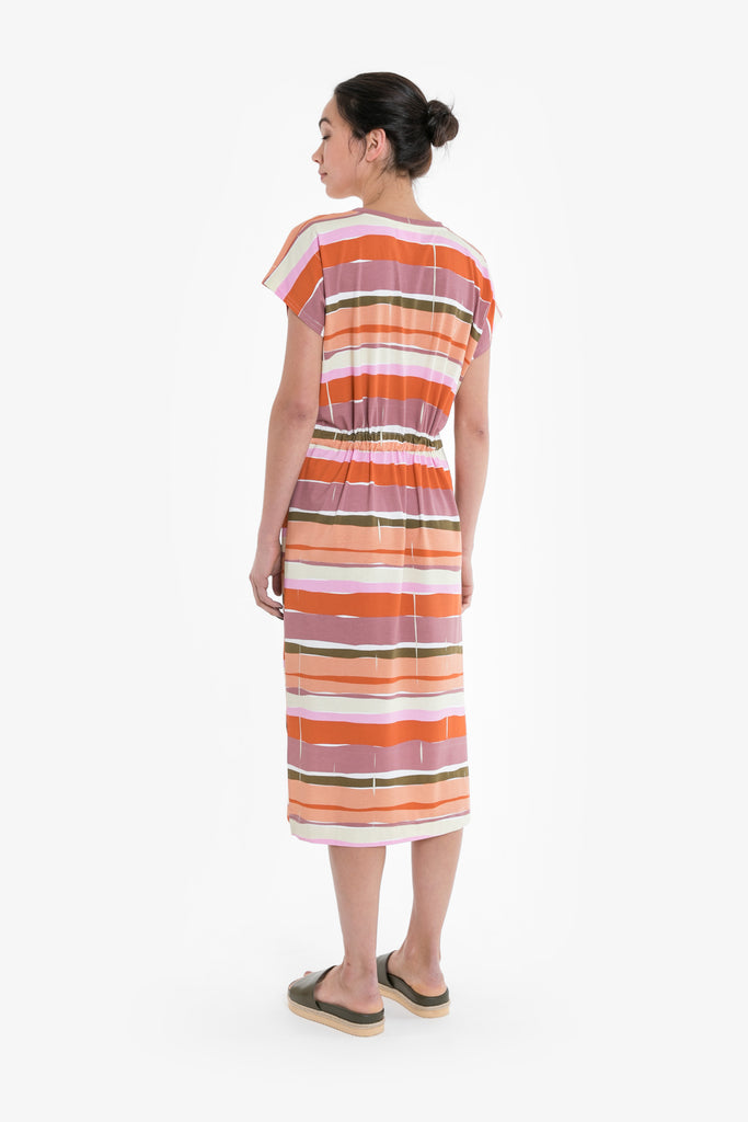 A graphic print of horizontal lines in premium jersey or linen blend, in a simple drawstring dress