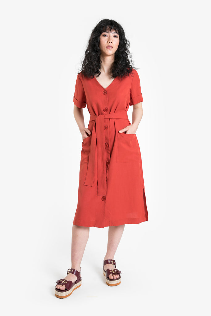 A below the knee button front shift dress with short sleeves and waist tie