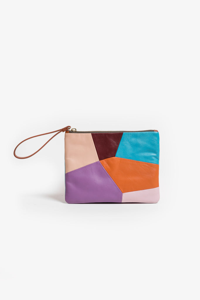 A patchwork leather purse/pouch with handle and gold zip