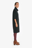 Loose fitting turtleneck dress with dropped shoulders, made from 100% merino wool.