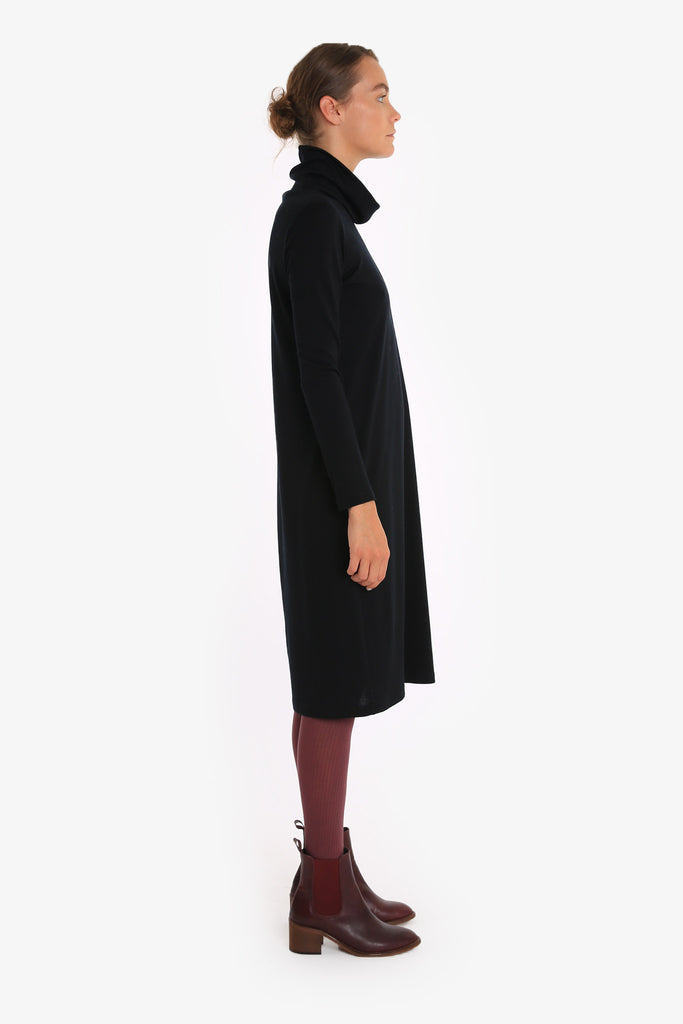A loose turtleneck dress made from Merino wool