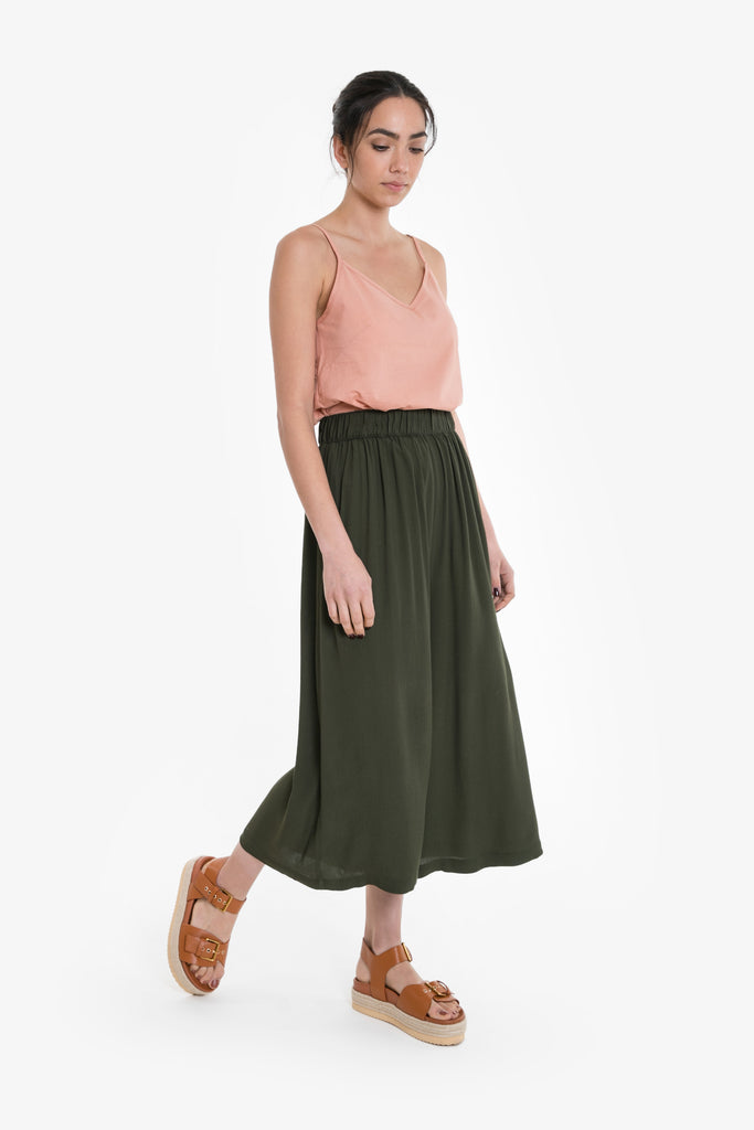 A wide legged culotte in forest green with an elastic waist, made from viscose