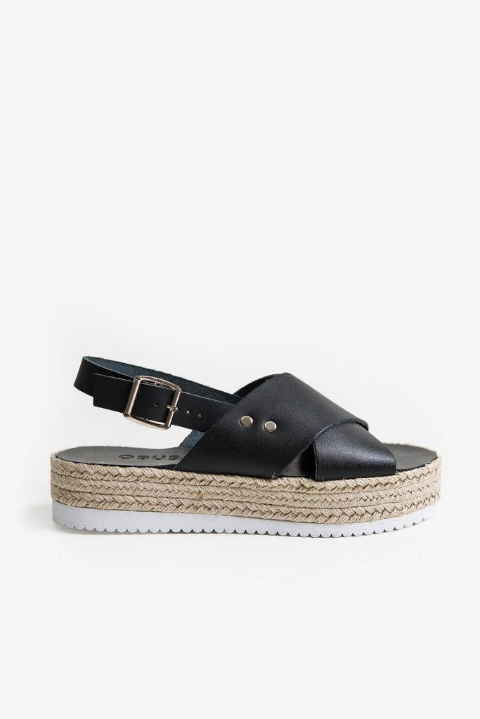 Black leather sandal with crossover straps and a plimsole platform sole