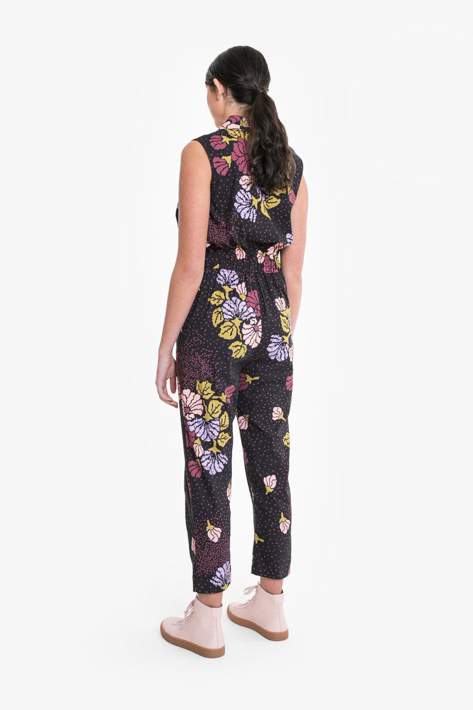 A sleeveless jumpsuit in a signature Obus print with ringpull zip front