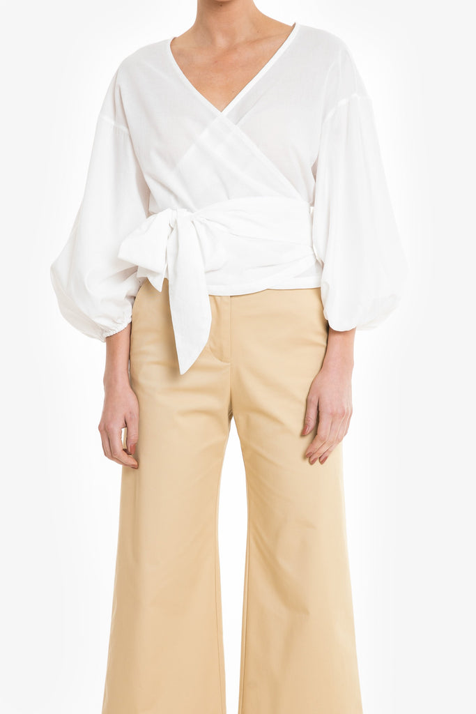 A simple summer wrap top in white cotton with balloon sleeves