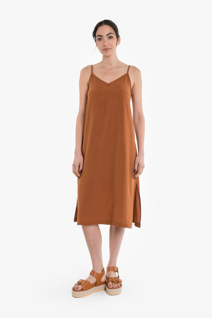 A simple slip dress in a burnt orange linen blend