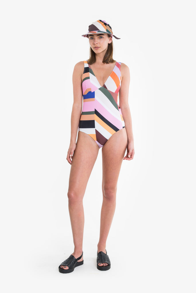 One piece bathers in a vintage style cut and bold, colourful print