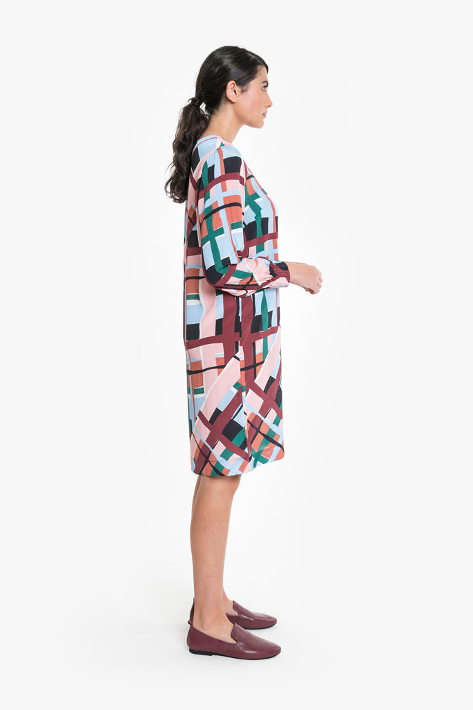 Along sleeved, above the knee dress in an oversized check print. Made from Viscose