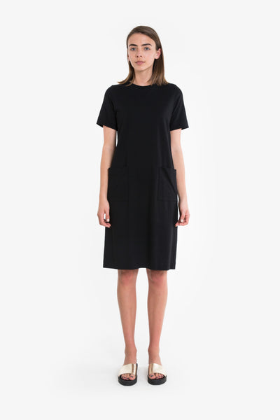 A slimline tshirt dress with crew neckline, classic short sleeves and long length below the knee. Tee dress is available in black/white stripe, black or pink/white stripe.