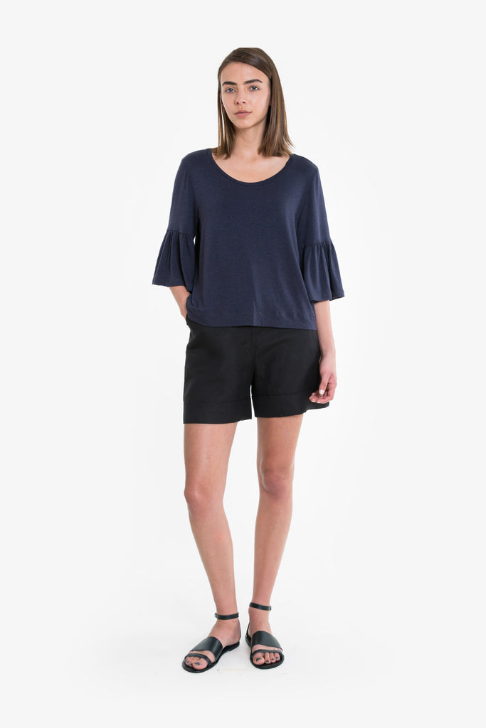 A drapey top with a ruffle sleeve made from premium jersey in dark blue