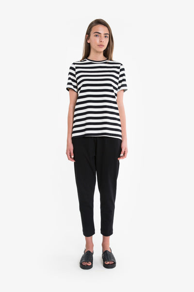 A slimline tshirt with crew neckline, classic short sleeves and long length, perfect for tucking in. Tee is available in black/white stripe, black or pink/white stripe.