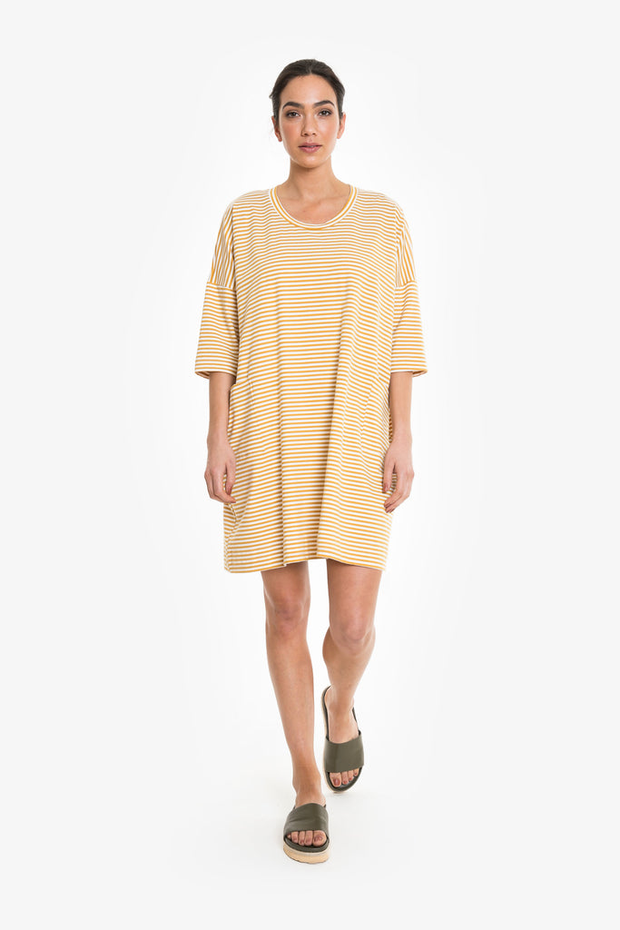 An oversized above the knee tee dress in fine white and yellow stripes
