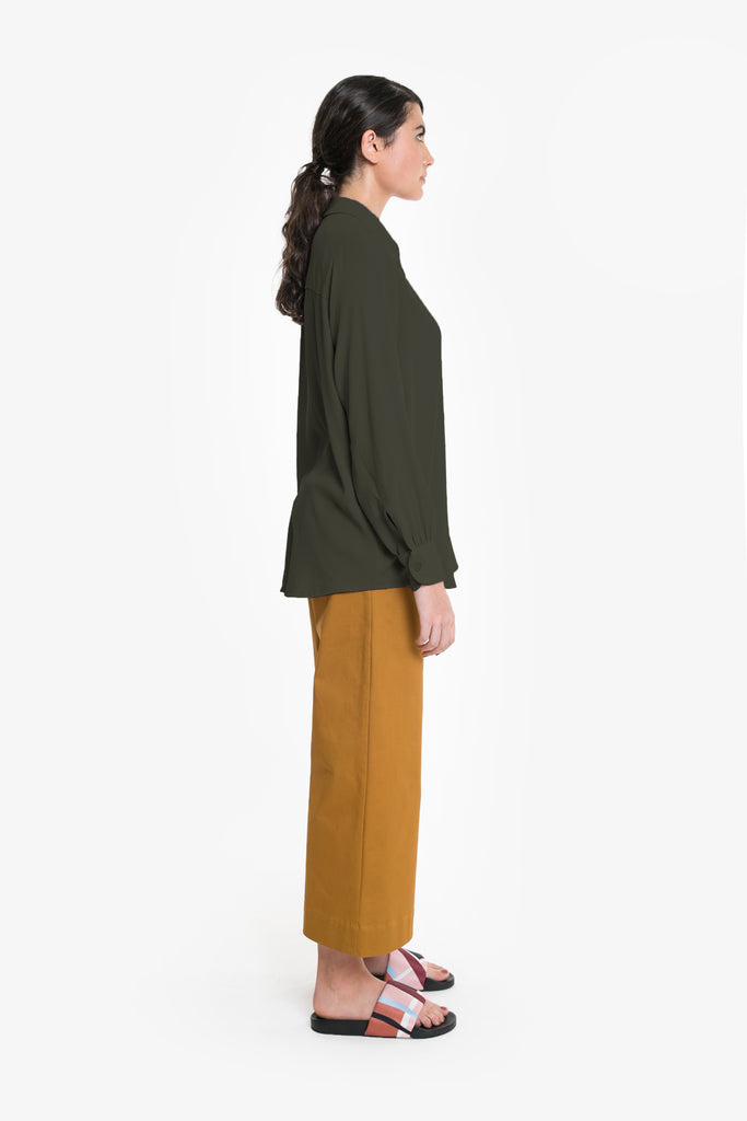 A drapey women's shirt in forest green. Made from viscose