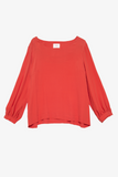 A long-sleeve vintage-style pullover blouse made from scarlet red viscose.