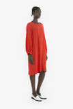 A long-sleeve vintage-style pullover dress made from scarlet red viscose.
