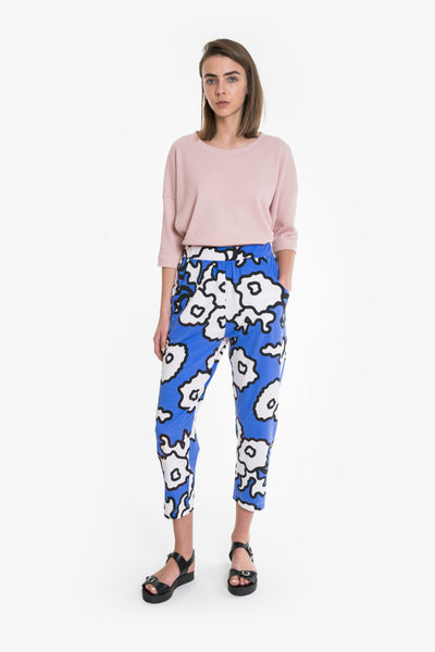 Elastic waisted cotton pants in a bold and bright Obus floral print. Tapered leg and side pockets.