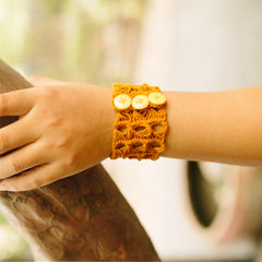 Penh Lane Broomstick Crochet Cuff Bracelet Mustard Yellow Model