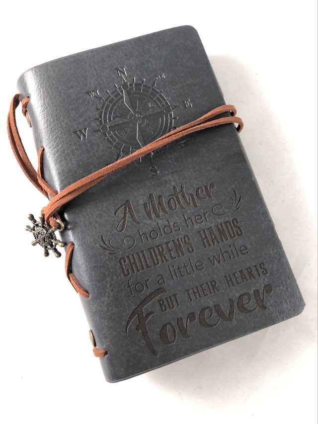 A Mother Holds Her Childrens Hand Engraved Journal