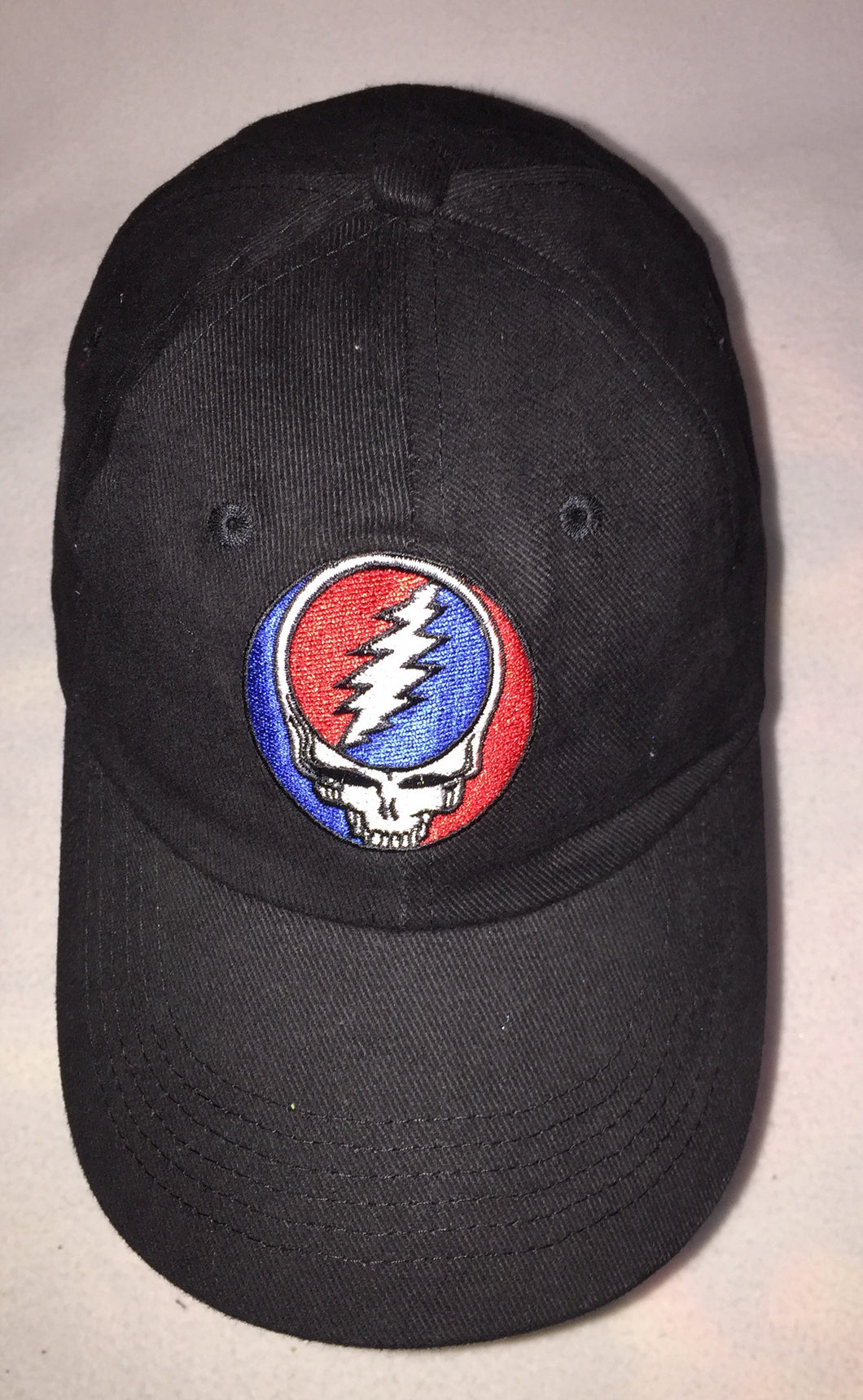 Steal Your Face on black cap.  Caps are adjustable and roomier than many previous GD caps